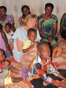 Sue McLaughlin-Beltz with group in Rwanda