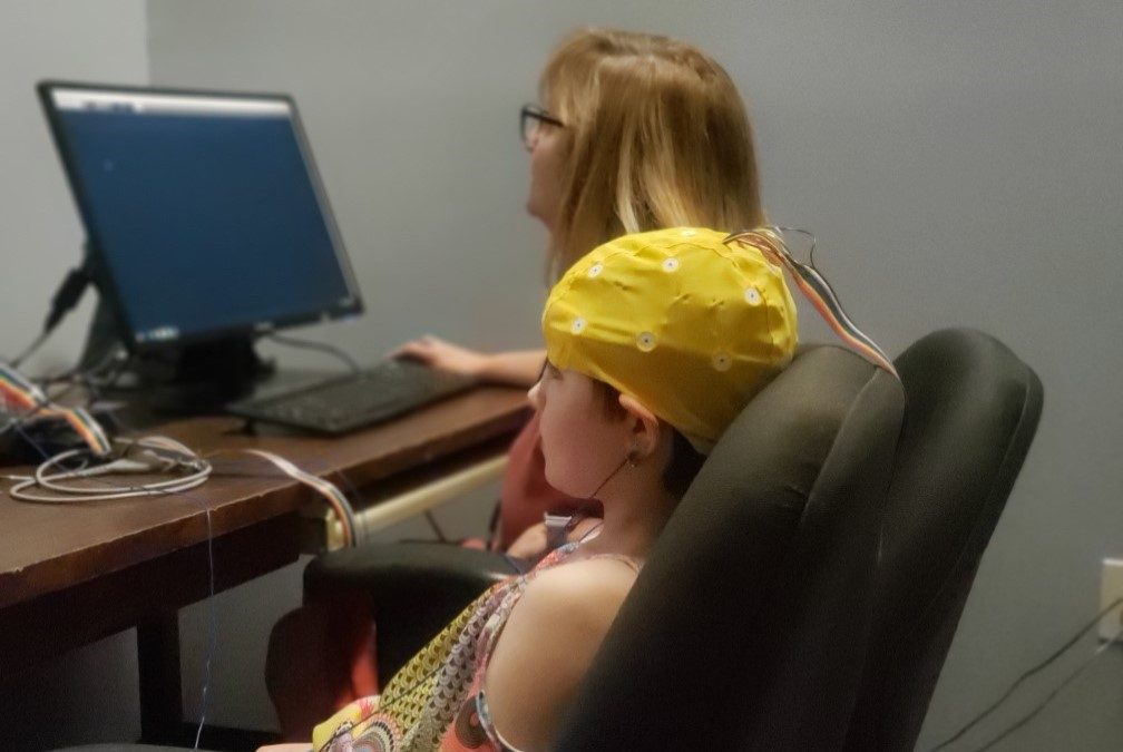 Young child with EEG cap undergoing testing