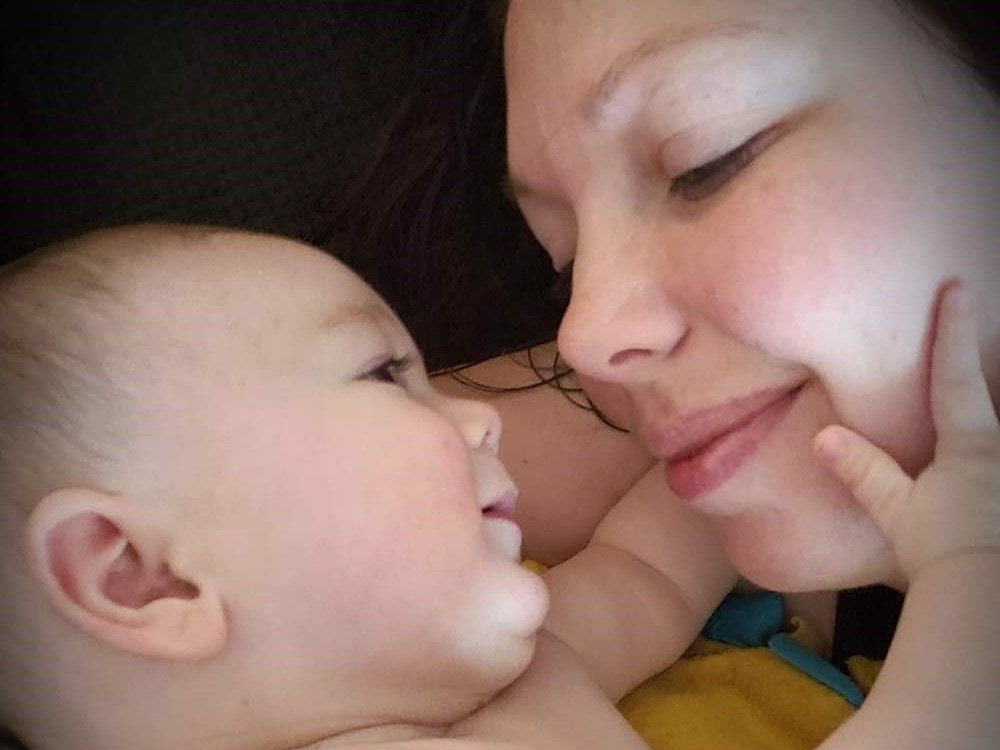 Infant stares adoringly at mom
